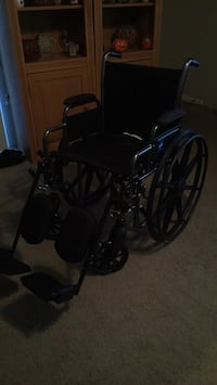 Black and gray wheelchair with elevating leg rests Tampa, 33647
