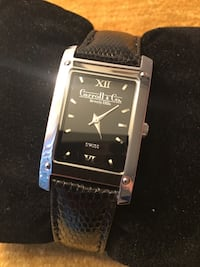 rectangular silver analog watch with silver link bracelet
