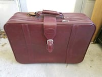 maroon suitcase w/ wheels