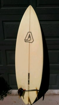 white and black surfboard with traction pad San Diego, 92128