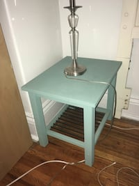 2 light blue side tables