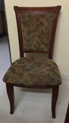 brown wooden frame and brown fabric padded armless chair