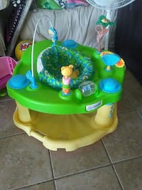 baby's green and yellow activity saucer