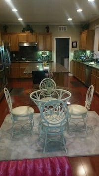 round clear glass table with four chairs dining se Moreno Valley
