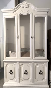 Off white Armoire with display case, cabinets, and drawers. Toronto, M6S 4Z1