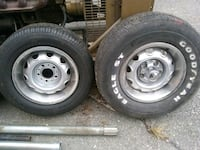gray bullet hole car wheel with tire set
