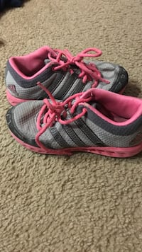 pair of gray-and-pink running shoes San Antonio, 78230