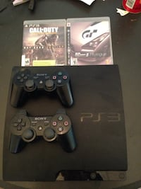 PS3 slim 160gb with 2 controllers and 2 games Port Coquitlam
