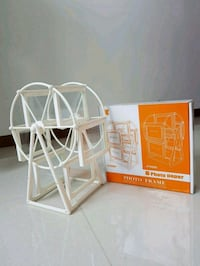 white farris wheel photo frame Singapore