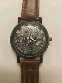 round black chronograph watch with brown leather strap Jersey City, 07306