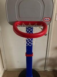 Red, blue, and grey little tikes basketball hoop toy with ball