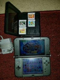 gray Nintendo DS with game cartridges