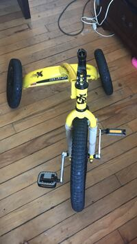 toddler's yellow and black pedal trike Alexandria, 22314