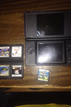 black Nintendo DS console set with games