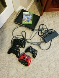 black Xbox 360 console with controllers and game cases Waterloo, N2K 1W9