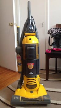 black and yellow Bissell upright vacuum cleaner