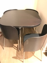 round brown wooden table with four chairs Anaheim, 92806