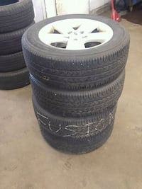 205 60 16 Firestone tires and Ford rims