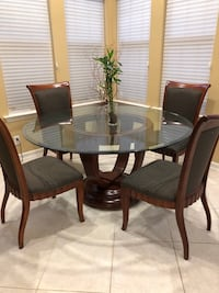 Round glass top table with four chairs dining set Huntington Beach, 92648