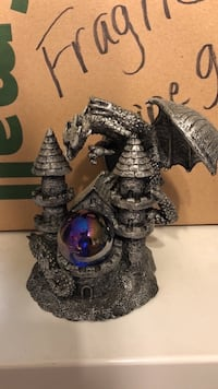 brown and black dragon figurine 1199 mi