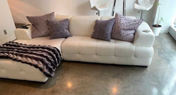 White leather L shaped sofa