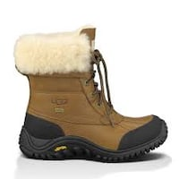 unpaired brown, black, and white Ugg sheepskin boots Size 9 used 5 times