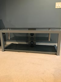 Silver and gray metal with tempered glass shelving tv stand. in great condition, willing to negotiate, all sales final. must be able to pick up. Royal Oak, 48073