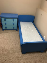 Blue wooden panel bed and 3-drawer nightstand