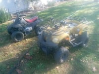 two black and yellow ATV's