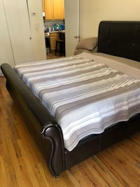 Brown leather bed frame with stained king size orthopedic mattress New York, 11102