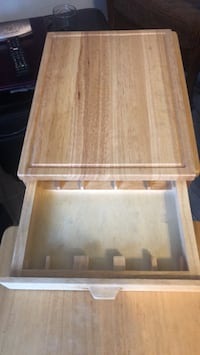 Cutting board with knife draw