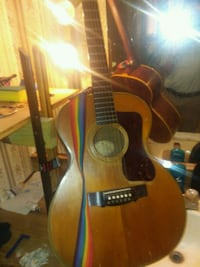 brown and black acoustic guitar Bossier City, 71111