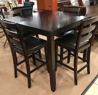 rectangular black wooden table with four chairs dining set Houston, 77077