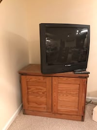 TV and TV Stand.  Stand is This End Up Furniture. Built Solid! 13 km