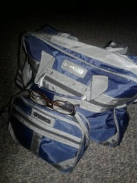 pair of gray-and-blue carry on bags 1404 mi