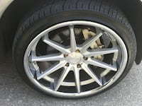 gray multi-spoke car wheel with tire