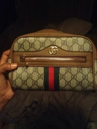 brown and gray Coach wristlet