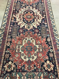red, white, and black floral area rug