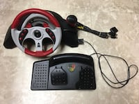 Black and red Mad Catz MC2 steering wheel controller