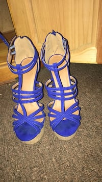 Pair of blue open toe ankle strap heels