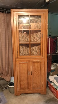 brown wooden framed glass cabinet Sioux Falls, 57104