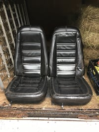 Two black leather car seats Centereach