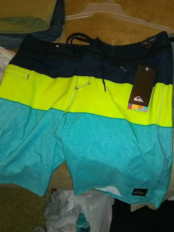 fc1fb277ea Used black, green, and teal Quiksilver board shorts for sale in Panama City  - letgo