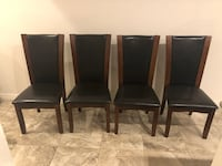 four black leather padded chairs Lake Buena Vista, 32830