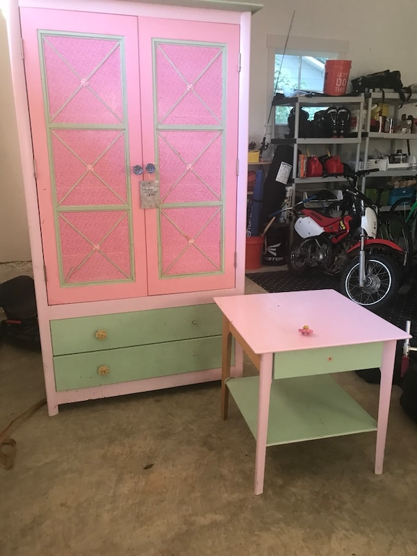White and pink wooden cabinet -