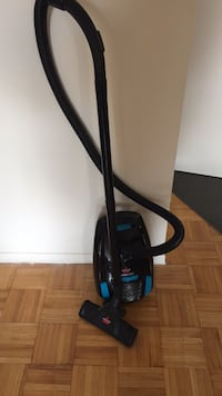 black and blue Bissell upright vacuum cleaner Toronto, M4R 2G3
