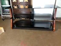 Brown wooden tv stand with mount Houston, 77083