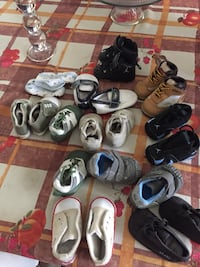 Assorted pairs of baby shoes and sandals
