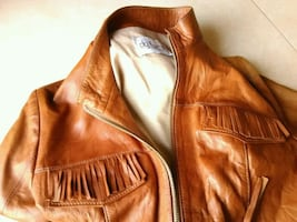 Ladies size S-M brand new, never worn soft leather jacket with fringe