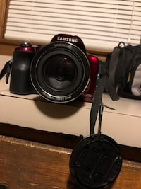 black Canon DSLR camera with lens Lexington, 27295